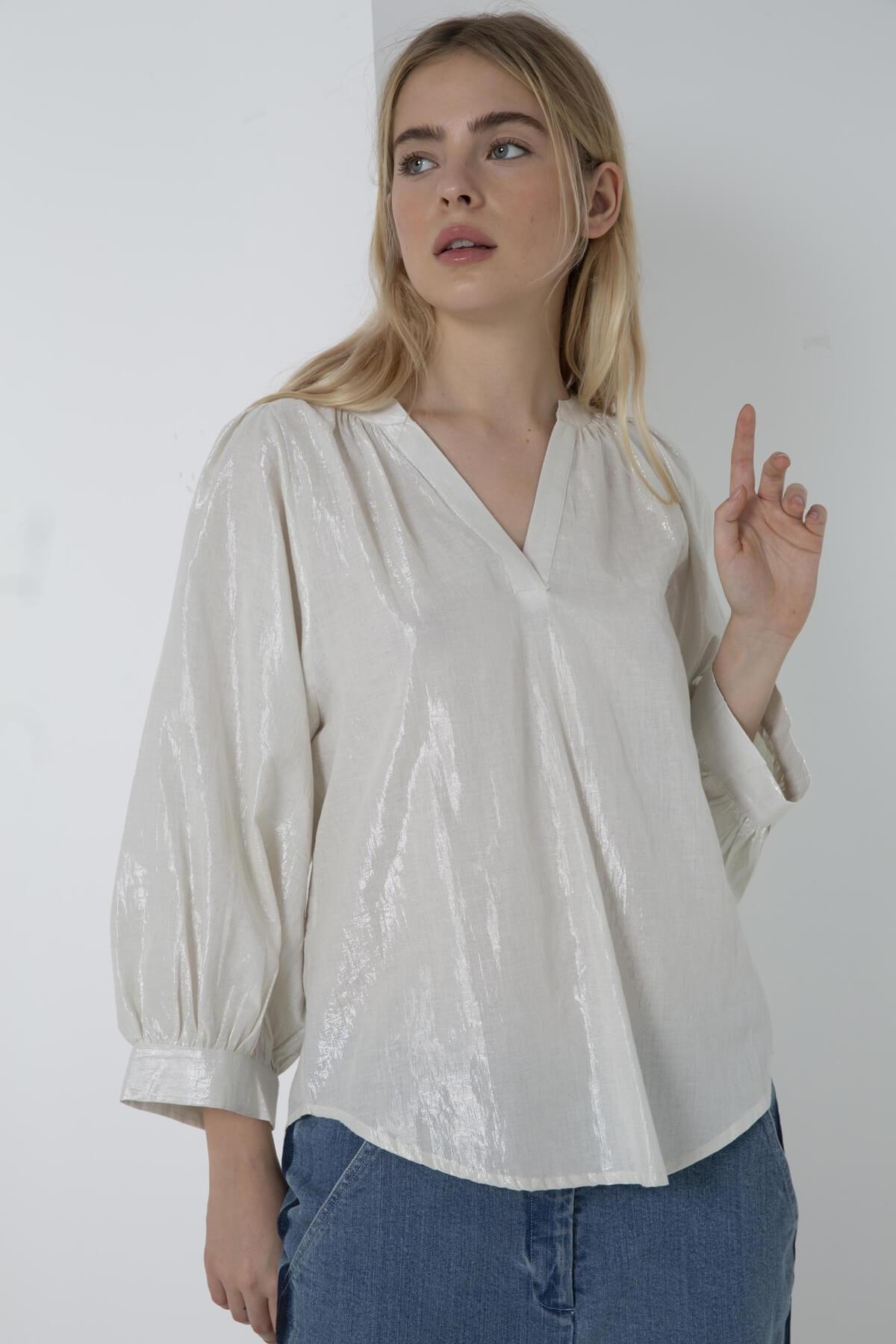 Chemise brillante à manche bouffante